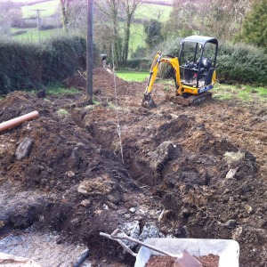 Digging garden for new pipe and guttering system